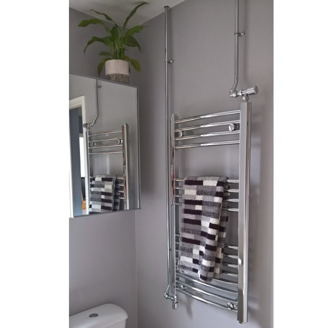 bathroom chrome towel rail and pipes